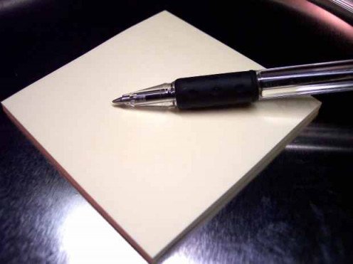 A pen on a note pad