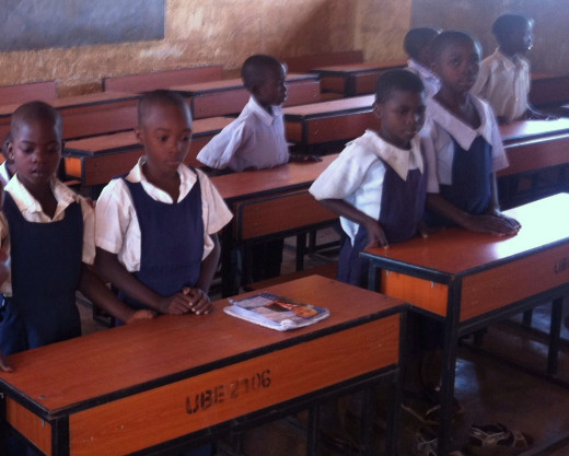 Nigerian classroom - Students stand and greet the teacher as s/he enters the class.