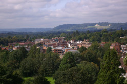 Reigate Town Centre; features visible include the clock tower of the Old Town Hall, and Box Hill in the North Downs