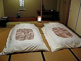 Japanese-style futons laid out for sleeping