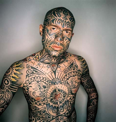 Check out the tattoo's on this guy.