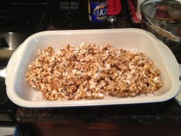 Mix the popcorn and peanuts in the candy mixture then place in greased baking dish