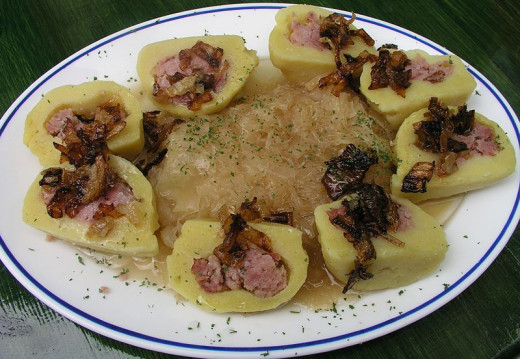Czech Potato dumplings stuffed with smoked meat, sauerkraut and fried onions
