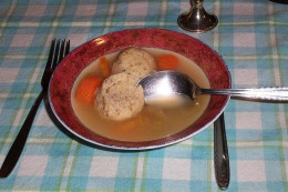 Matzah balls in clear soup