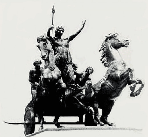 This is the statue of Boudicca and her daughters on the Victoria Embankment near Westminster Bridge opposite the Palace of Westminster.  London SW1 . Note 'scythes' mounted on the wheel hubs - courtesy wordinfo.info