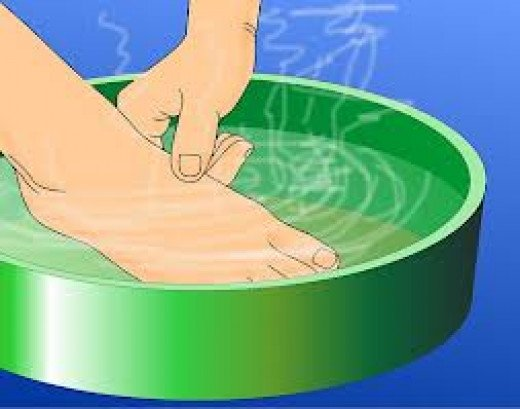 Soaking of foot in warm water