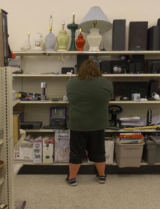 Thrift store electronics shelf aisle