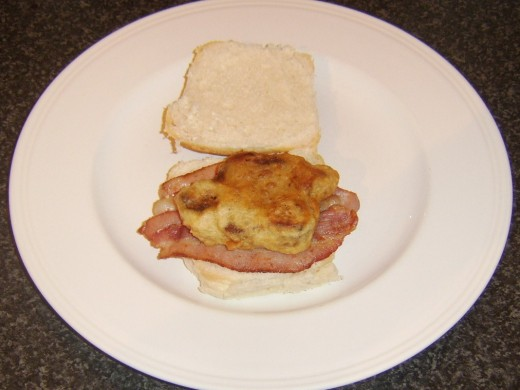 Prok fritter is added to bacon on roll