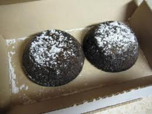The Lava Crunch Cakes have hot, melted chocolate in the center and powdered sugar on the top.