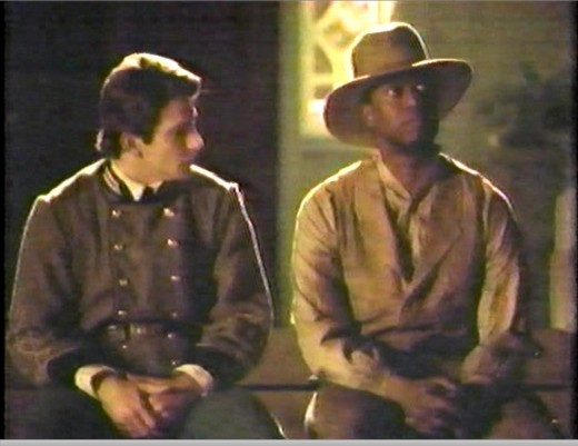 Dan Futterman, right, as Shelby and Andre Braugher as his boyhood friend and slave Lucius.
