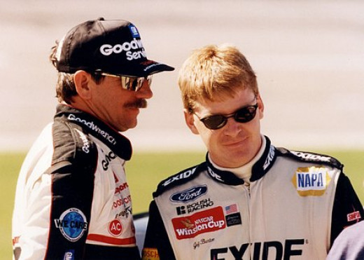 A young Burton trades words with NASCAR legend Dale Earnhardt Sr