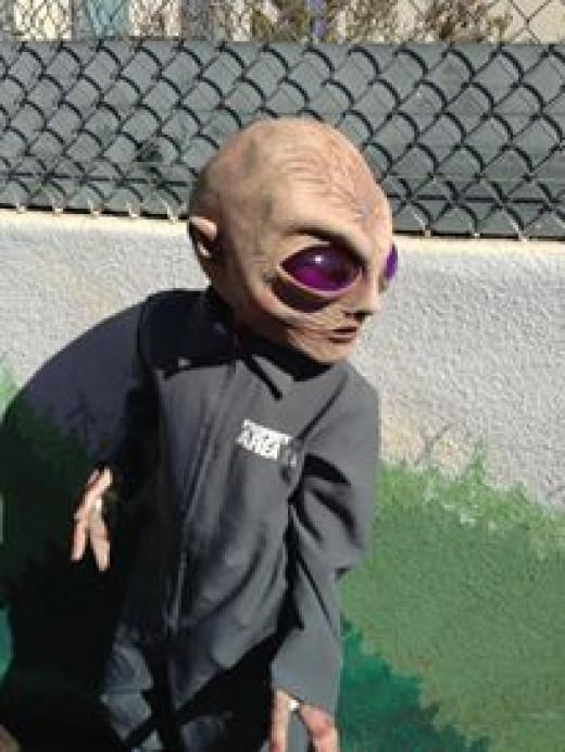 Ari posing in his Alien Costume.