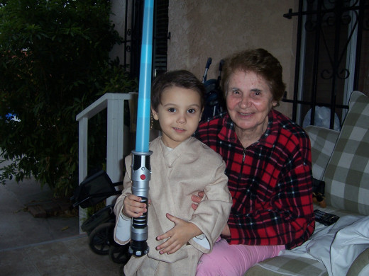 Ari dressed up as a Jedi Knight with Grandma.