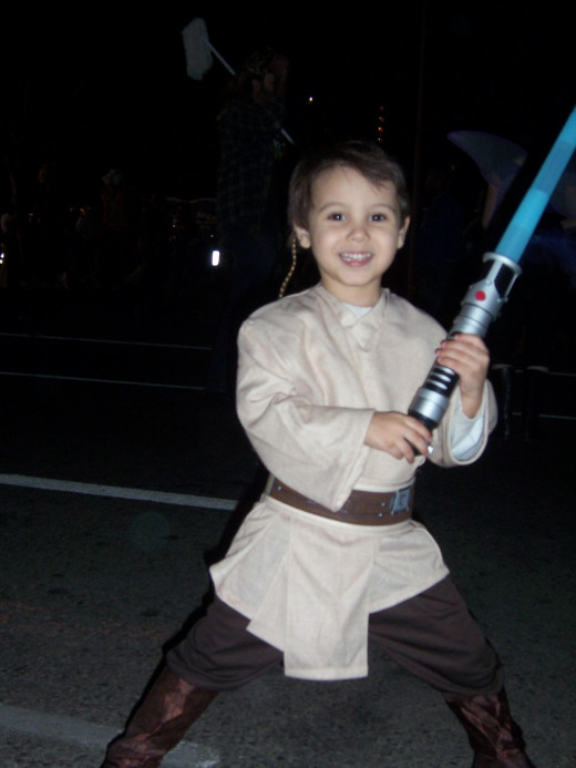 Ari posing in his Jedi Knight costume on Halloween.