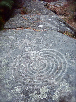 Rock drawing of a classical labyrinth in Valcamonica, Italy.