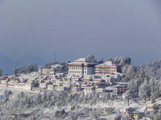 The Tawang Monastery dominates the landscape with an aura of spirituality. Seen here during winter months as a source of warmth.