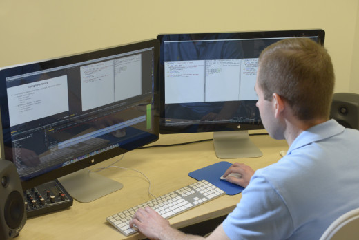 One of edX's video editors edits a lecture in a video suite.