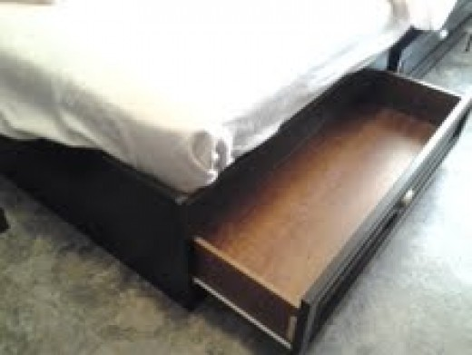 The drawer in the bed.
