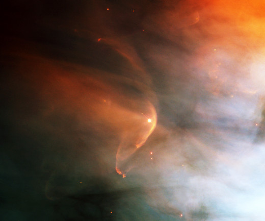 "The curved structure in the photo was created by the ""wind"" produced by the collision of the star L.L. Orionis with the Orion Nebula flow."