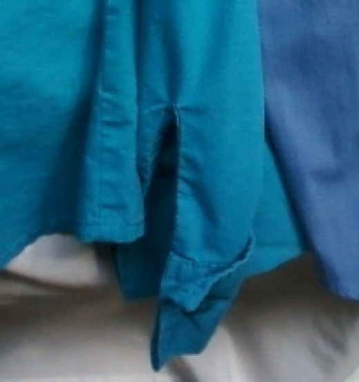 A close-up of a full-length sleeve and cuff to be altered.