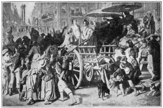 """Enemies of the people"" (wealthy nobles who did not flee the country during the French Revolution) headed for the guillotine during The Reign of Terror."