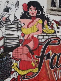Graffiti of Maria Severa. She was a famous singer of Fado music, which is described as Portugal's 'The Blues' music. Fado roughly translates to the word fate.  Photo taken in Lisbon, Portugal.