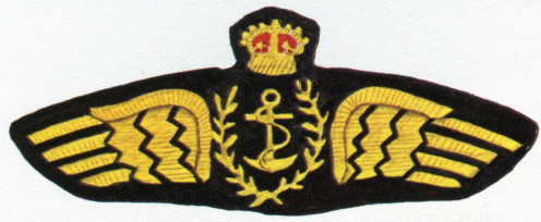 RFC Naval Wing Cloth Breast Badge designed by Eric Gill in 1912 (not adopted). The Public Records Office, London has the original.