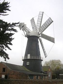 A traditional windmill used to grind corn in a renewable way.