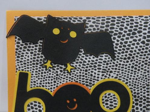 Bat layers adhered to card