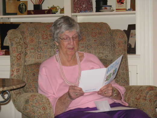 Mom, savoring a card on her 83rd birthday