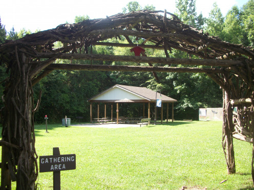 Behind the Nature Center is an entrance to one of the many picnic shelters available to enjoy. What a lovely sunny day it is in this photo!