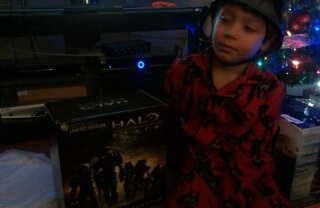 """Christmas brought him an XBox and a """"Army"""" helmet."""