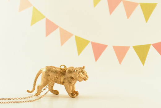 metallic gold lion pendant