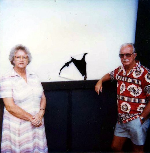 My late parents, Ken and Betty Bond, unimpressed with the punched hole through the screen by Canberra High School students.
