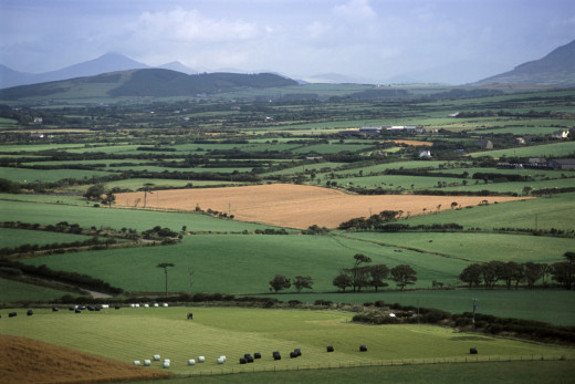 Rolling countryside leads to rugged mountains - what we think of at the mention of Wales - Cymru to native speakers