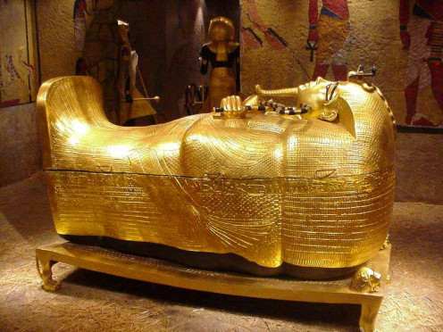 This is a photograph of a box-like funeral receptacle for a corpse, most commonly carved in stone, and displayed above ground; although some are buried.  Do you know what it is called?  The one pictured here is King Tut's.