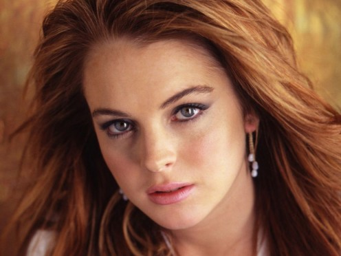 Lindsay Lohan almost looks sane in this picture but don't be fooled.  How did she get so many friends???  But, move over Lindsay, and make room for Miley!!