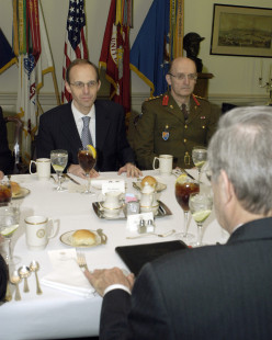Secretary of Defense Donald H. Rumsfeld (foreground) meets with Luxembourg's Minister of Defense Luc Frieden (left) and the Chief of Staff of the Luxembourg Army Col. Nico Ries in the Pentagon on Jan. 31, 2005
