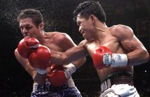 Oscar Larios, seen here taking a hard right from Manny Pacquiao, had tremendous heart and will in the squared circle.