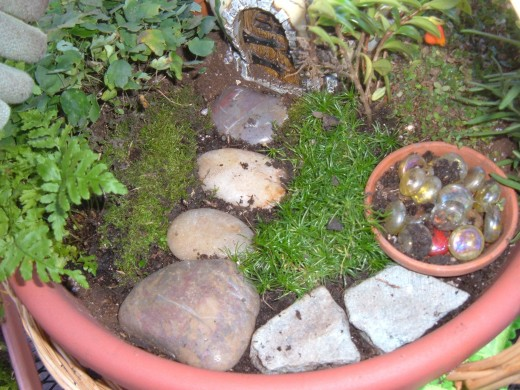 This photo shows how you can create a nice front step using a stone that hugs the shape of the house.