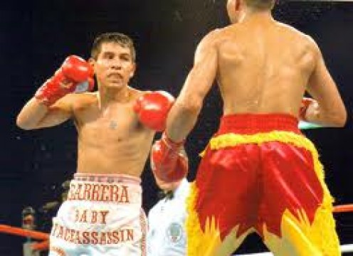 Marco Antonio Barrera and Kennedy McKinney fought in a brawl with Barrera finally prevailing by knockout in the 12th and final round.