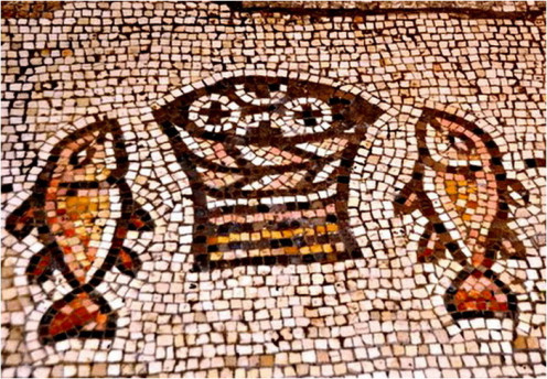 Symbol of two fish and 4 loaf of bread at the church of multiplication in Tabgha
