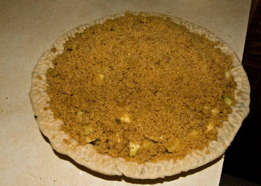 Crumb topping sprinkled on pie filling-photo by AMB