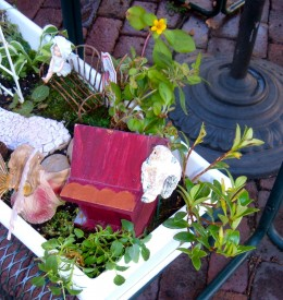 Placing fairies in small groups or alone is an option. Here I placed a fairy on the bench and another one nearby.