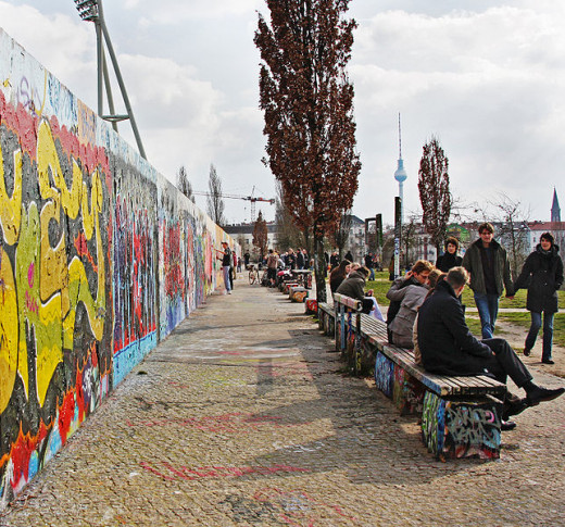 Strolling through Mauerpark along the, now colorful,  Wall