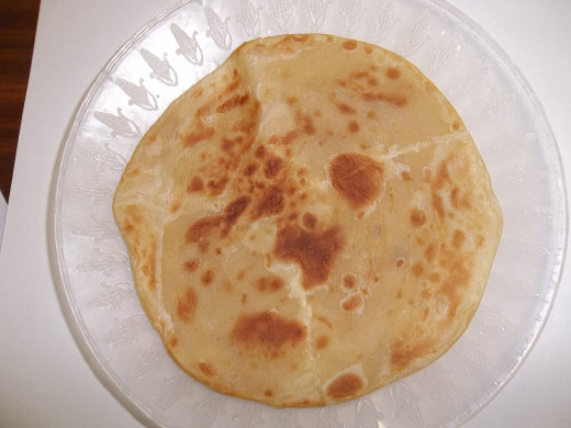 A fresh well done chapati. Two of these orbs make a very fulfilling lunch, with a drink of course.