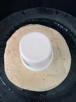 A small container anchoring the center of the tortillas.