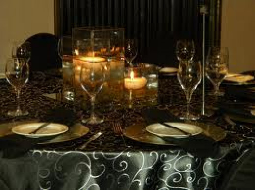 Selecting a tablecloth with a design can allow for less table decor.