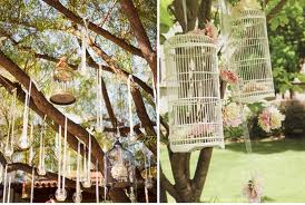 Birdcages and old ornaments are a nice outdoor wedding feature.
