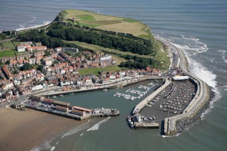 Gannet's eye view of Scarborough and its harbour - at the top is the castle, below that the old town, on the right is the marina, bottom left is the south bay beach and in the foreground the fish harbour and lighthouse